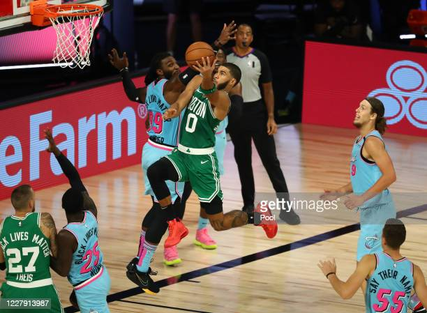 Jayson Tatum of the Boston Celtics drives to the basket against Jae Crowder of the Miami Heat in the second half of an NBA game at HP Field House at...