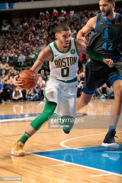 Jayson Tatum of the Boston Celtics drives to the basket against the Dallas Mavericks on November 24 2018 at the American Airlines Center in Dallas...