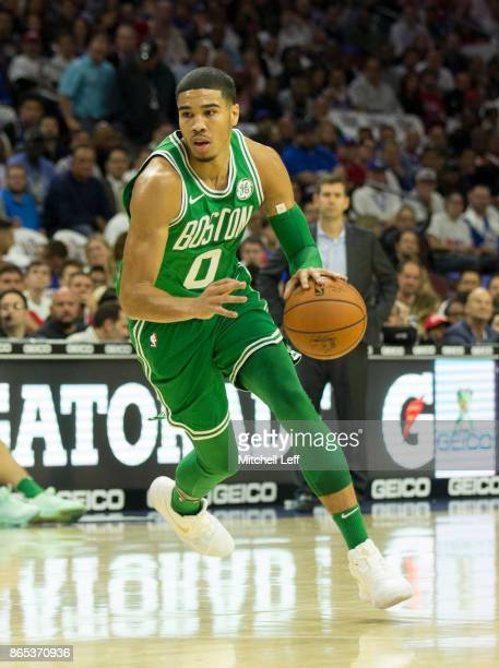 Jayson Tatum of the Boston Celtics drives to the basket against the Philadelphia 76ers at the Wells Fargo Center on October 20 2017 in Philadelphia...