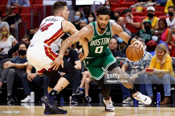 Jayson Tatum of the Boston Celtics drives to the basket against Tyler Herro of the Miami Heat during the second half of a preseason game at FTX Arena...