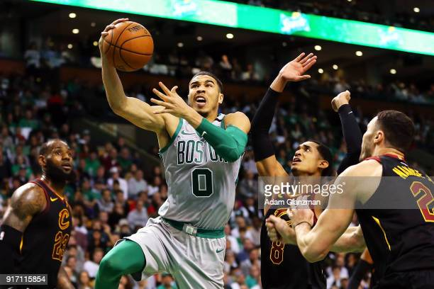 Jayson Tatum of the Boston Celtics drives to the basket during a game against the Cleveland Cavaliers at TD Garden on February 11 2018 in Boston...