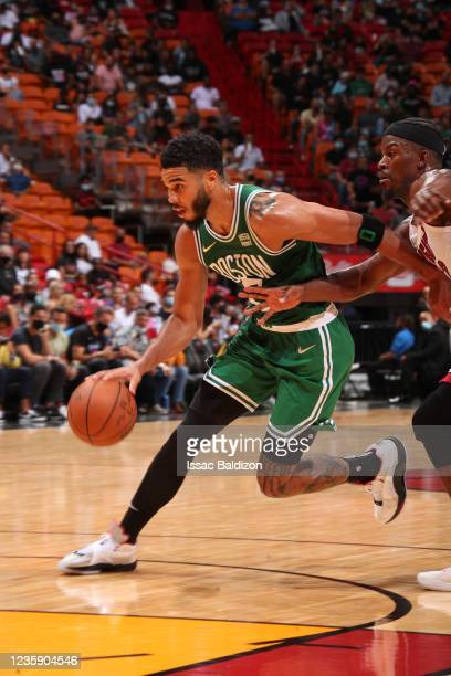 Jayson Tatum of the Boston Celtics drives to the basket during a preseason game against the Miami Heat on October 15, 2021 at FTX Arena in Miami,...
