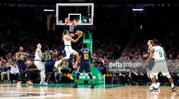 Jayson Tatum of the Boston Celtics drives to the basket during the fourth quarter of the game against the Utah Jazz at TD Garden on March 06 2020 in...