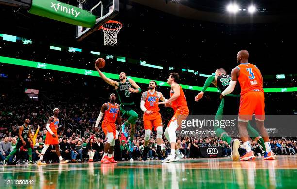 Jayson Tatum of the Boston Celtics drives to the basket during the fourth quarter of the game against the Oklahoma City Thunder at TD Garden on March...