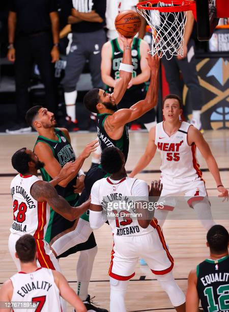 Jayson Tatum of the Boston Celtics drives to the basket during the third quarter against the Miami Heat in Game Five of the Eastern Conference Finals...