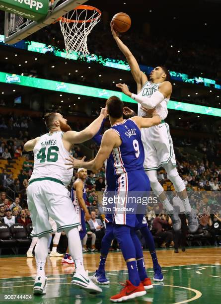 Jayson Tatum of the Boston Celtics drives to the basket during the first half against the Philadelphia 76ers at TD Garden on January 18 2018 in...