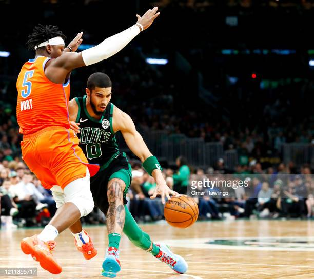 Jayson Tatum of the Boston Celtics drives to the basket on Luguentz Dort of the Oklahoma City Thunder during the fourth quarter of the game at TD...