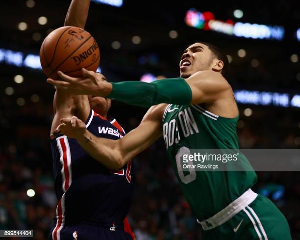 Jayson Tatum of the Boston Celtics drives to the basket on Otto Porter Jr #22 of the Washington Wizards during the game at TD Garden on December 25...
