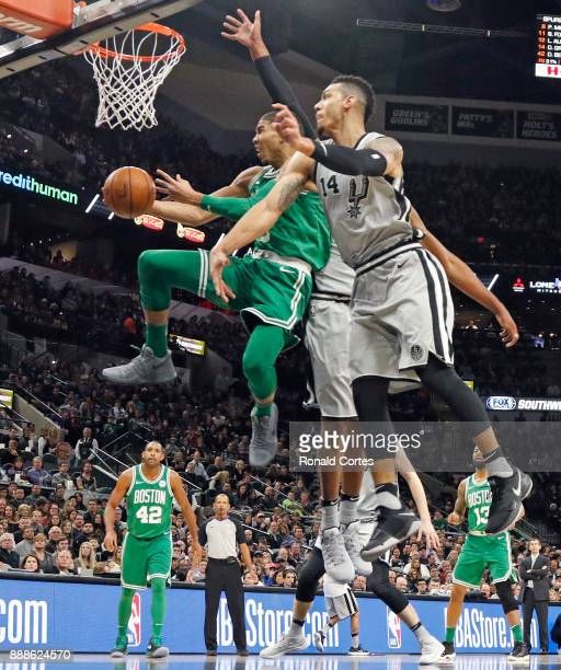 Jayson Tatum of the Boston Celtics drives under Danny Green of the San Antonio Spurs at ATT Center on December 08 2017 in San Antonio Texas NOTE TO...