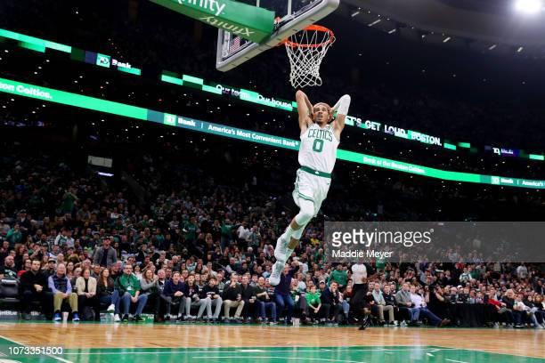 Jayson Tatum of the Boston Celtics dunks during the game between the Boston Celtics and the Atlanta Hawks at TD Garden on December 14 2018 in Boston...