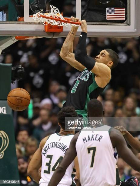 Jayson Tatum of the Boston Celtics dunks over Giannis Antetokounmpo and Thon Maker of the Milwaukee Bucks during Game Four of Round One of the 2018...