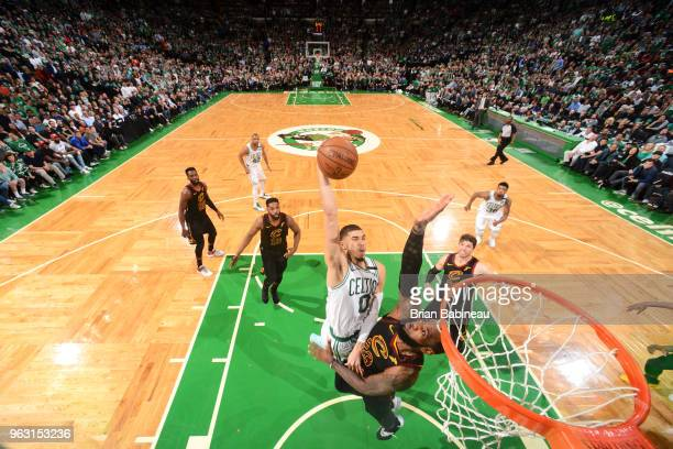 Jayson Tatum of the Boston Celtics dunks the ball against LeBron James of the Cleveland Cavaliers during Game Seven of the Eastern Conference Finals...