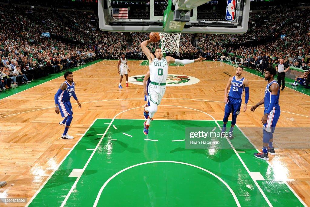 Jayson Tatum of the Boston Celtics dunks the ball against the Philadelphia 76ers on October 16 2018 at the TD Garden in Boston Massachusetts NOTE TO...