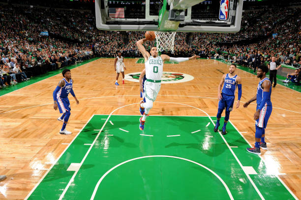 Jayson Tatum of the Boston Celtics dunks the ball against the Philadelphia 76ers on October 16 2018 at the TD Garden in Boston Massachusetts NOTE TO...