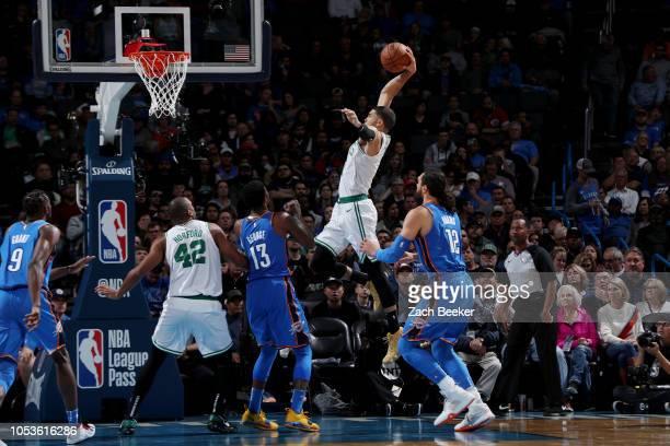 Jayson Tatum of the Boston Celtics dunks the ball against the Oklahoma City Thunder on October 25 2018 at Chesapeake Energy Arena in Oklahoma City...
