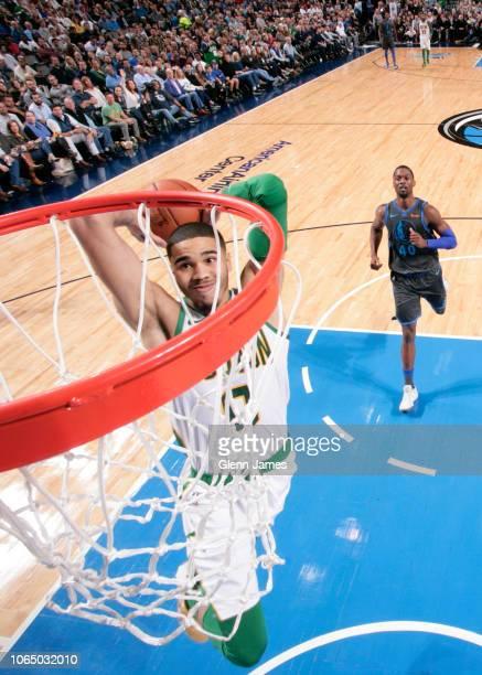 Jayson Tatum of the Boston Celtics dunks the ball against the Dallas Mavericks on November 24 2018 at the American Airlines Center in Dallas Texas...