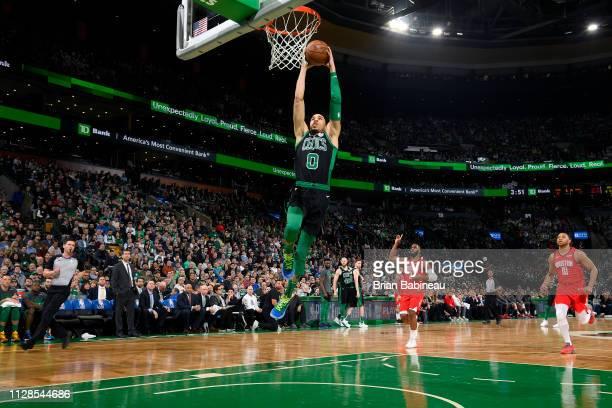 Jayson Tatum of the Boston Celtics dunks the ball against the Houston Rockets on March 3 2019 at the TD Garden in Boston Massachusetts NOTE TO USER...