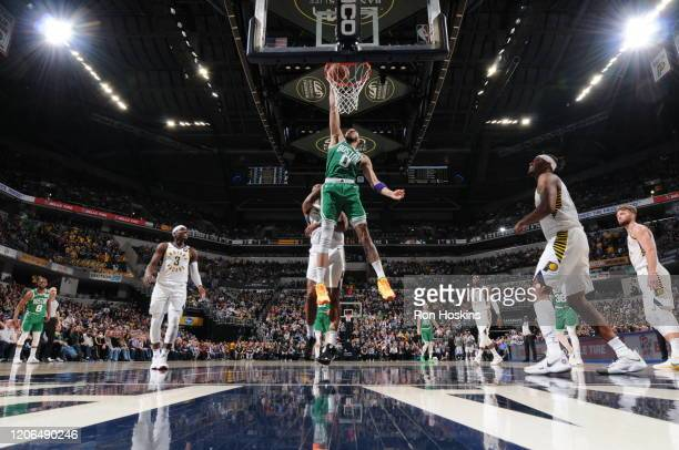 Jayson Tatum of the Boston Celtics dunks the ball against the Indiana Pacers on March 10 2020 at Bankers Life Fieldhouse in Indianapolis Indiana NOTE...
