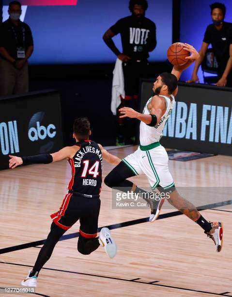 Jayson Tatum of the Boston Celtics dunks the ball against Tyler Herro of the Miami Heat during the second quarter in Game Six of the Eastern...