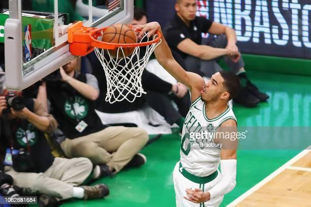 Jayson Tatum of the Boston Celtics dunks the ball during the first half against the Toronto Raptors at TD Garden on November 16 2018 in Boston...