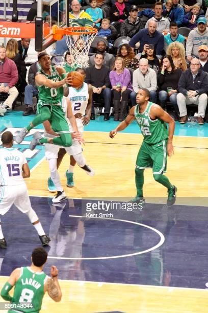 Jayson Tatum of the Boston Celtics dunks the ball during the game against the Charlotte Hornets on December 27 2017 at Spectrum Center in Charlotte...
