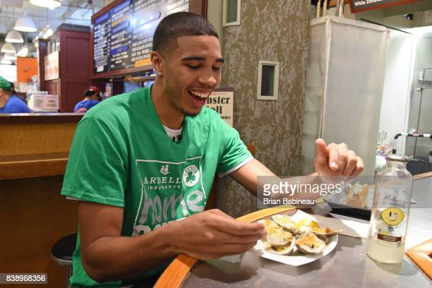 Jayson Tatum of the Boston Celtics eats food during a tour around Boston Massachusetts on August 24 2017 NOTE TO USER User expressly acknowledges and...