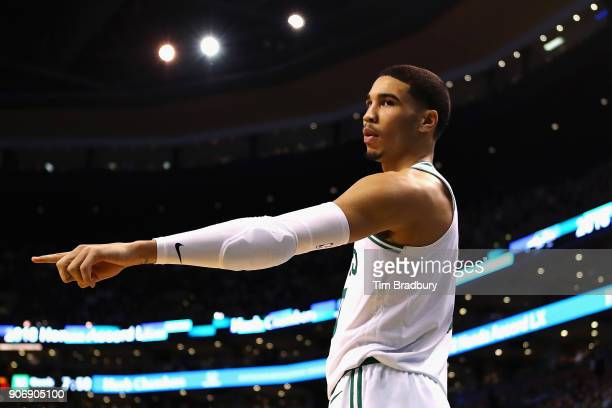 Jayson Tatum of the Boston Celtics gestures during the first half against the Philadelphia 76ers at TD Garden on January 18 2018 in Boston...