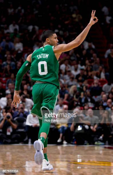 Jayson Tatum of the Boston Celtics gestures during the second half of the game against the Miami Heat at the American Airlines Arena on October 28...