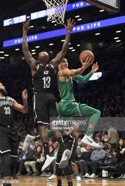 Jayson Tatum of the Boston Celtics goes to the basket against Quincy Any of the Brooklyn Nets during the first half of the NBA Game on November 14...