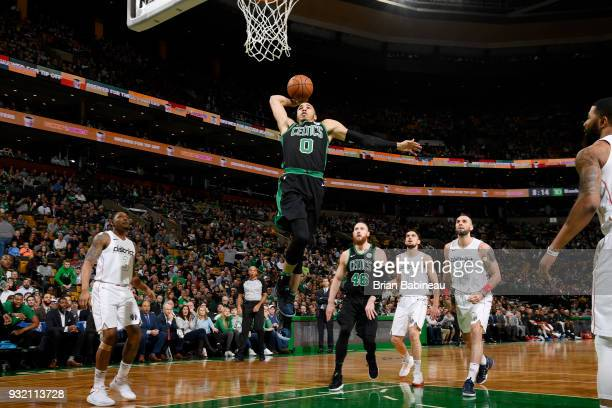 Jayson Tatum of the Boston Celtics goes up for a dunk against the Washington Wizards on March 14 2018 at the TD Garden in Boston Massachusetts NOTE...