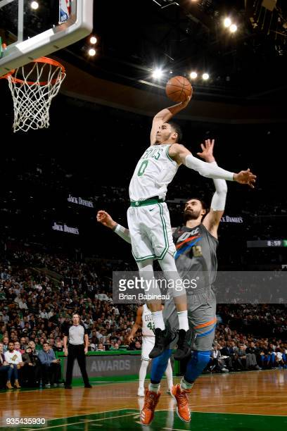 Jayson Tatum of the Boston Celtics goes up for a dunk against the Oklahoma City Thunder on March 20 2018 at the TD Garden in Boston Massachusetts...