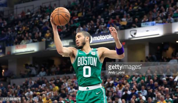 Jayson Tatum of the Boston Celtics grabs a rebound against the Indiana Pacers at Bankers Life Fieldhouse on March 10 2020 in Indianapolis Indiana...