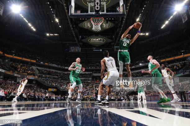 Jayson Tatum of the Boston Celtics grabs the rebound against the Indiana Pacers on March 10 2020 at Bankers Life Fieldhouse in Indianapolis Indiana...