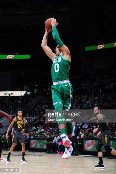 Jayson Tatum of the Boston Celtics grabs the rebound against the Atlanta Hawks on November 18 2017 at Philips Arena in Atlanta Georgia NOTE TO USER...