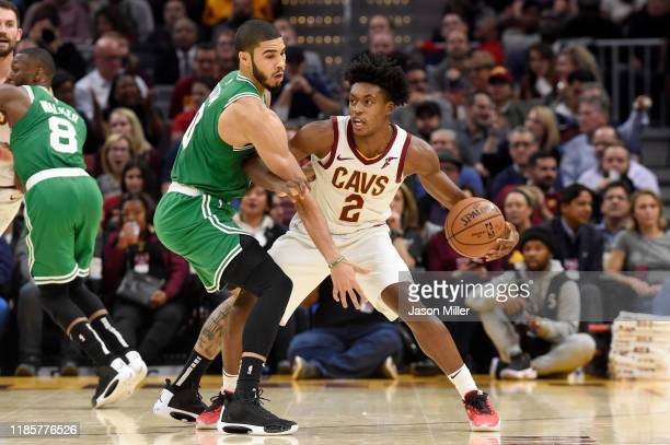 Jayson Tatum of the Boston Celtics guards Collin Sexton of the Cleveland Cavaliers during the second half at Rocket Mortgage Fieldhouse on November...