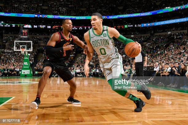 Jayson Tatum of the Boston Celtics handles the ball against Rodney Hood of the Cleveland Cavaliers during the game between the two teams on February...
