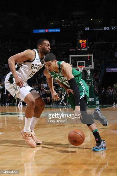 Jayson Tatum of the Boston Celtics handles the ball against the Milwaukee Bucks in Game Three of Round One of the 2018 NBA Playoffs on April 20 2018...