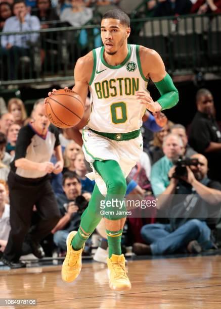 Jayson Tatum of the Boston Celtics handles the ball against the Dallas Mavericks on November 24 2018 at the American Airlines Center in Dallas Texas...