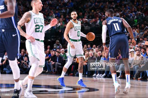 Jayson Tatum of the Boston Celtics handles the ball against the Dallas Mavericks on December 18 2019 at the American Airlines Center in Dallas Texas...
