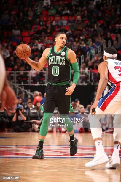 Jayson Tatum of the Boston Celtics handles the ball against the Detroit Pistons on December 10 2017 at Little Caesars Arena in Detroit Michigan NOTE...