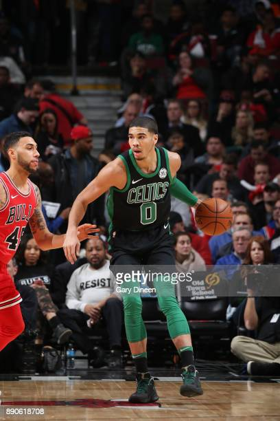 Jayson Tatum of the Boston Celtics handles the ball against the Chicago Bulls on December 11 2017 at the United Center in Chicago Illinois NOTE TO...