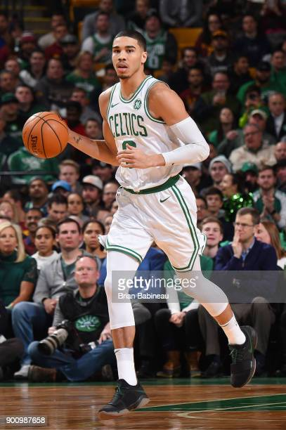 Jayson Tatum of the Boston Celtics handles the ball against the Cleveland Cavaliers on January 3 2018 at the TD Garden in Boston Massachusetts NOTE...