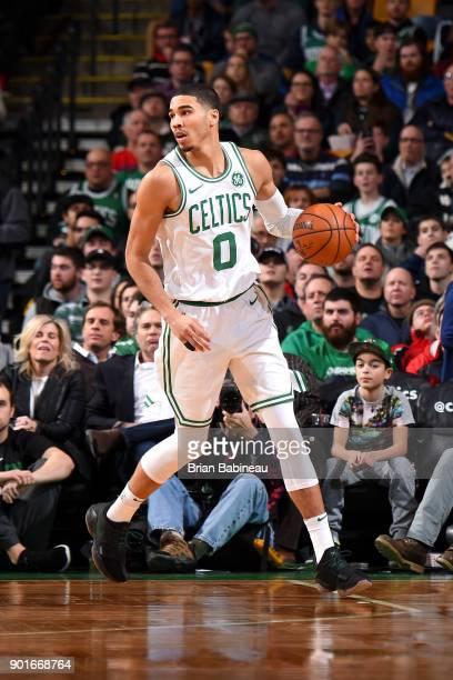 Jayson Tatum of the Boston Celtics handles the ball against the Minnesota Timberwolves on January 5 2018 at the TD Garden in Boston Massachusetts...