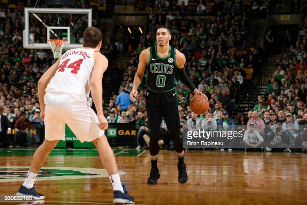 Jayson Tatum of the Boston Celtics handles the ball against the Indiana Pacers on March 11 2018 at the TD Garden in Boston Massachusetts NOTE TO USER...