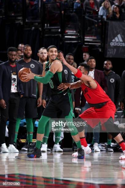 Jayson Tatum of the Boston Celtics handles the ball against the Portland Trail Blazers on March 23 2018 at the Moda Center in Portland Oregon NOTE TO...