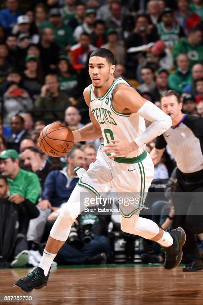 Jayson Tatum of the Boston Celtics handles the ball during the game against the Dallas Mavericks on December 6 2017 at the TD Garden in Boston...