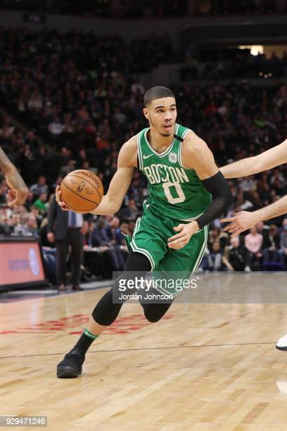 Jayson Tatum of the Boston Celtics handles the ball during the game against the Minnesota Timberwolves on March 8 2018 at Target Center in...