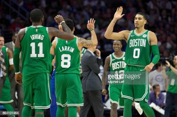 Jayson Tatum of the Boston Celtics high fives Kyrie Irving and Shane Larkin in the fourth quarter against the Philadelphia 76ers at the Wells Fargo...
