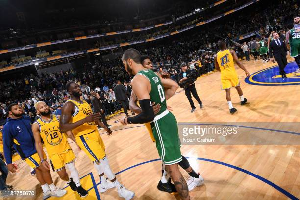 Jayson Tatum of the Boston Celtics hugs Glenn Robinson III of the Golden State Warriors after the game on November 15 2019 at Chase Center in San...