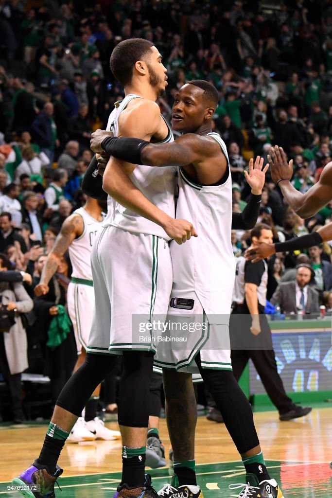 Jayson Tatum #0 of the Boston Celtics hugs Terry Rozier #12 of the Boston Celtics after the game against the Milwaukee Bucks in Game One of Round One during the 2018 NBA Playoffs on April 15, 2018 at TD Garden in Boston, Massachusetts.